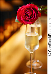 valentine day - red roses and glass of champagne