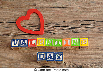 Valentine Day. Spelled with colorful alphabet blocks and a red heart