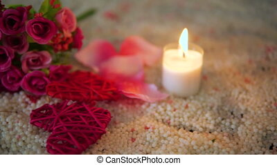 Valentine day with footage decoration heart, candle burning and bouquet