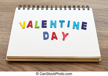 valentine day word on notebook with valentine's day concept