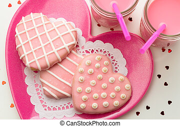 Valentine Decorated Cookies - Pink heart cookies on pink...
