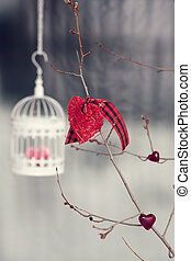 Valentine decorations. Bird cage with knitted heart