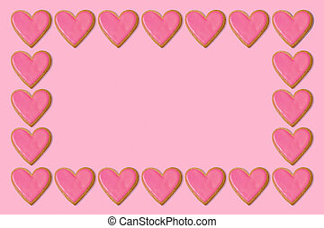Valentine gift background. Pink heart cookie frame border. Love concept. Copy space