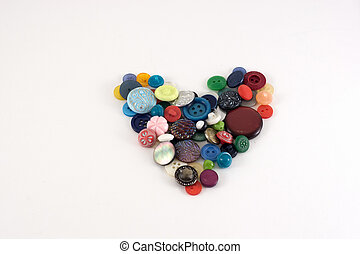 Valentine Heart of color buttons. Various sewing buttons set on white background.