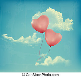 Valentine heart-shaped baloons in a blue sky with clouds. ...