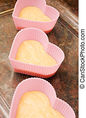 Valentine heart shaped cup cakes - Three pink heart shaped...
