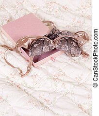 Pink gift box with beautiful brown lace lingerie