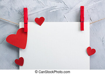 Valentine, love background with paper and hearts on a rope