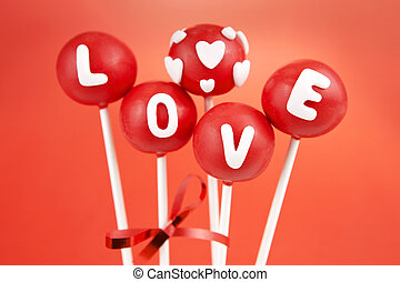 Valentine pop cakes - Red cake pops garnished with letters...