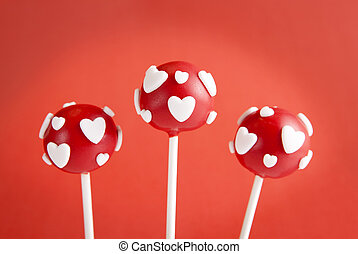 Valentine pop cakes - Red pop cakes garnished with...