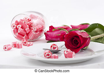 Candy on dish with rose
