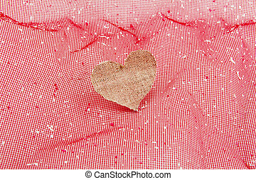 vintage fabric heart on rose background
