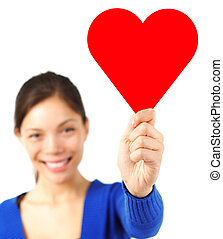 Valentine woman holding heart card / sign