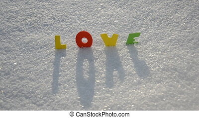 Valentine word love on snow