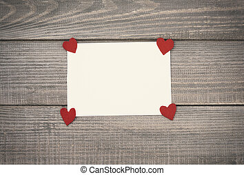 Valentine's card on wooden table