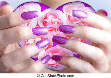 valentines card-Rose and hearts in female hands with beautiful manicure