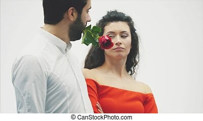 Valentine's Couple in Love. Beauty is a fashion model girl with a beautiful model guy dancing together. Pair of glamor, romantic date. Valentine's Day Concept