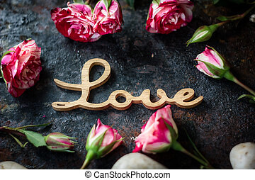 Valentine's day background on rustic surface - word LOVE
