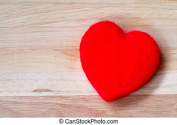 Valentines Day background red heart on wooden backgroundValentines Day background red heart on wooden background