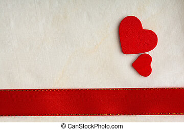 Valentines day background. Red satin ribbon and hearts.