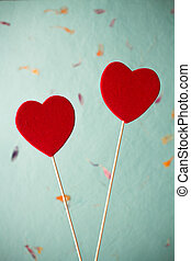Valentine's day background. - Two red hearts on a stick, ...