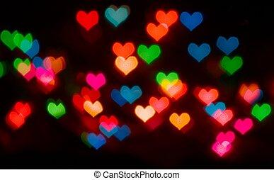 Valentine's Day background with blur defocusing heart bokeh