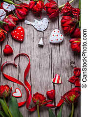 Valentines Day background with chocolates, hearts and red...