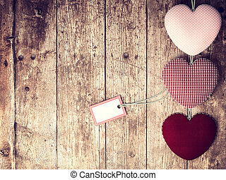 Valentines Day background with patterned textile hearts on ...