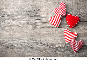 Valentines Day background with patterned textile hearts on...