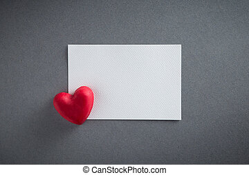 Valentines Day background with red chocolates heart shape and white paper from top view. Copy space