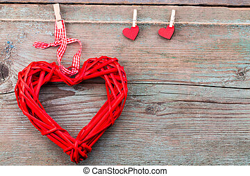 Valentine's day background with red hearts on wooden planks