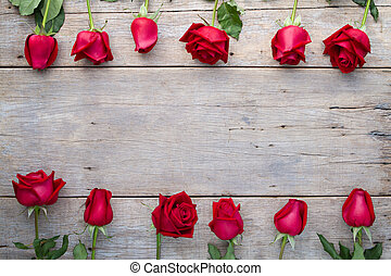 Valentines day background with red roses on wooden.