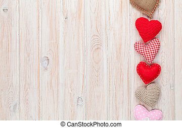 Valentines day background with toy hearts