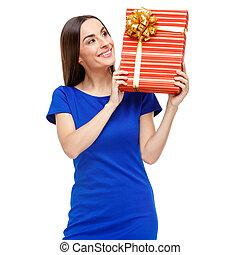 Beautiful woman holding gift box