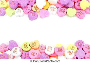 Double edge border of Valentines Day candy hearts over white