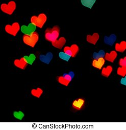 Valentine's Day card background with blur defocusing colour hear