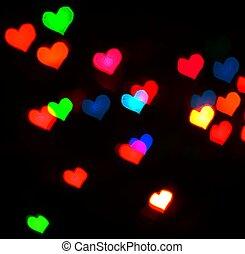 Valentine's Day card background with colour blur defocusing hear
