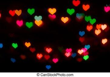 Valentine's Day card background with blur defocusing heart bokeh