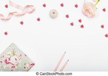 Valentine's day card with little candies in the form of a heart on a white background. Flat lay