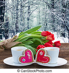 Valentines day coffee with fresh tulips on wooden table with winter backdrop