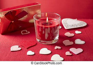 Valentines day composition with candle,gift box  and hearts