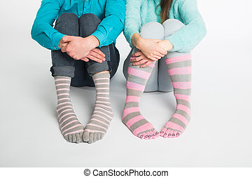 Valentine's day concept - Male and female legs in socks.