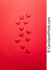 Valentines day concept of red hearts on a red background. Flat lay, top view, copy space