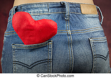 valentine's day concept, red heart in pocket