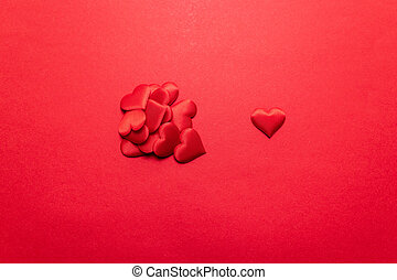 Valentines day concept. Red hearts on a red background. Flat lay, top view