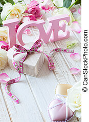 """Valentine's day concept with gift box, letters """"love"""" and ..."""