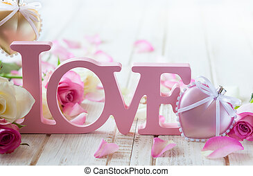 """Valentine's day concept with letters """"love"""" and flowers on ..."""
