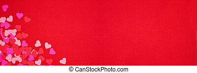 Valentines Day corner border banner with heart confetti on a red background with copy space