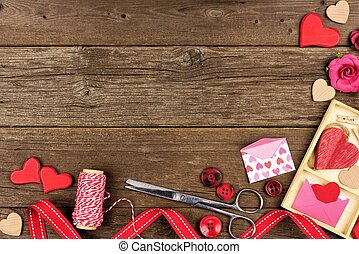 Valentines Day craft concept corner border against rustic wood