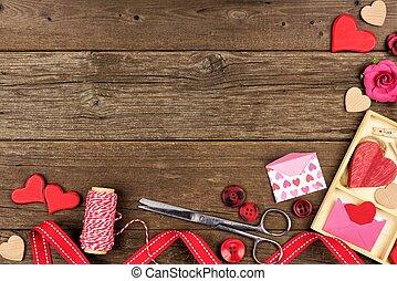 Valentines Day craft concept corner border against rustic wood